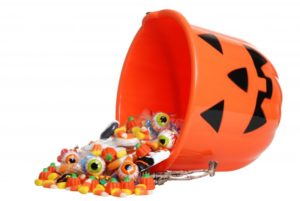 A bucket spilling Halloween candy.