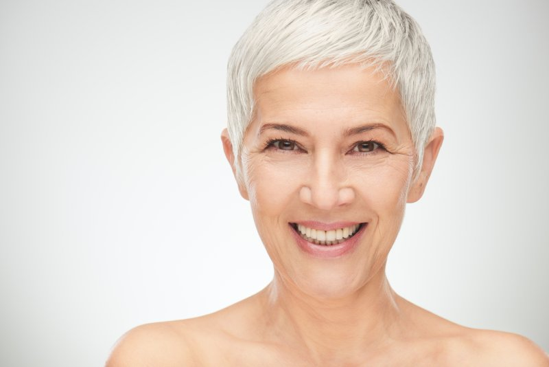 older woman smiling silver hair