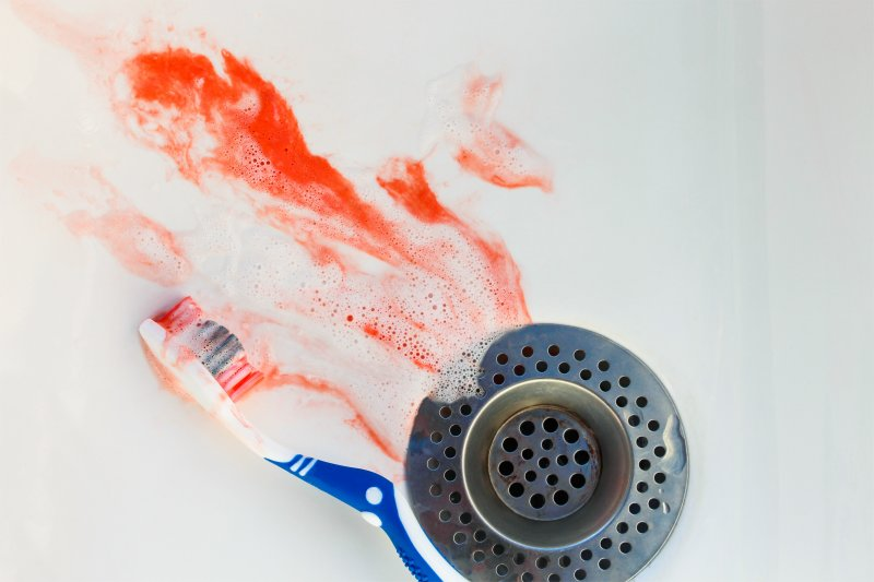 toothbrush and blood in sink