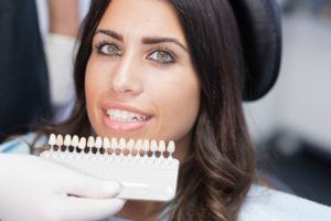 woman getting veneers from her dentist