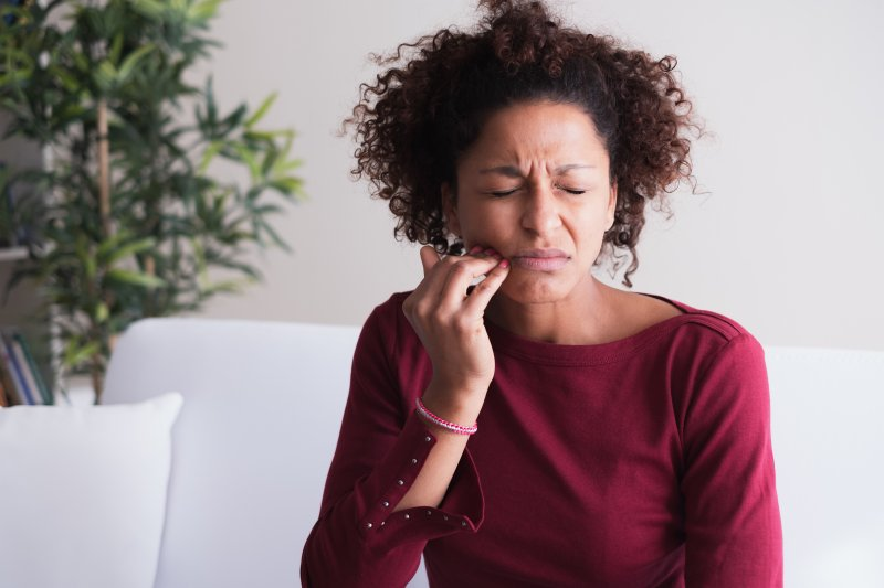 Woman with toothache needing to see dentist