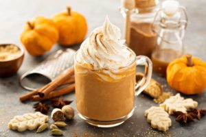 Seasonal hot drinks surrounded by other fall treats