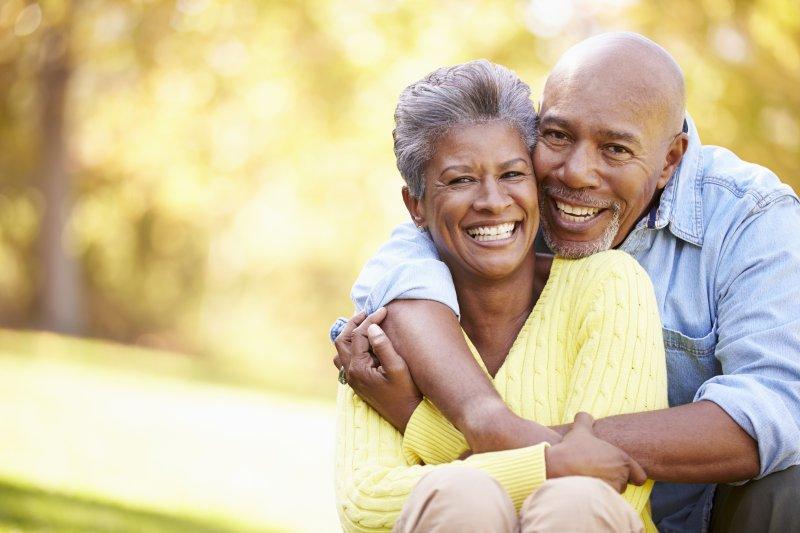 senior couple smiling outdoors